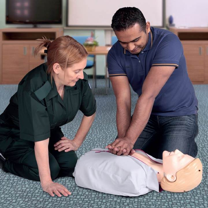 Performing CPR under instruction