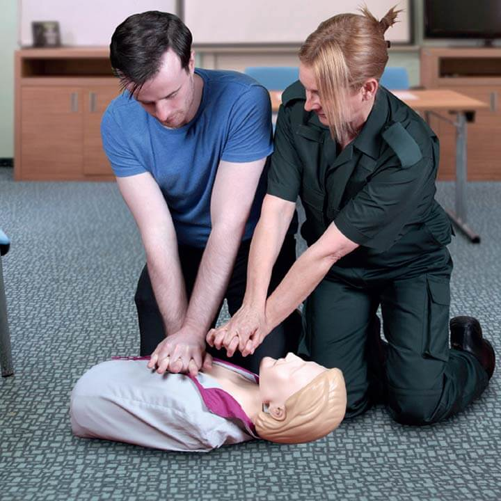Two people performing CPR