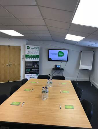 "Training room which is available for hire for training or meetings, comfortably seating 12-16 people, with use of the 52"" HDMI-ready monitor, refreshments included and on site toilet facilities. This image is from the perspective of delegates facing the HDMI-ready monitor."